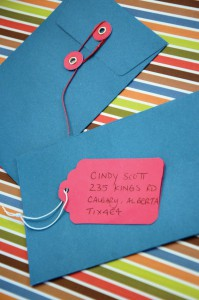 Fasten a tag to the front of a coloured envelope for your next invitation